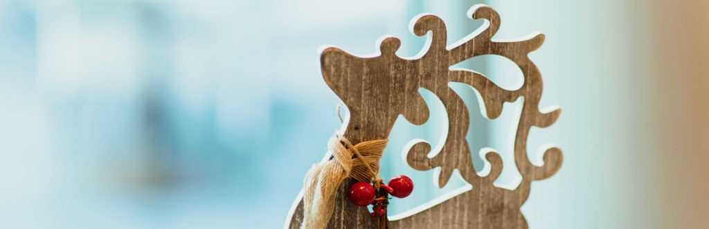 Photo image of a wooden reindeer tabletop ornament used for a blog post titled,