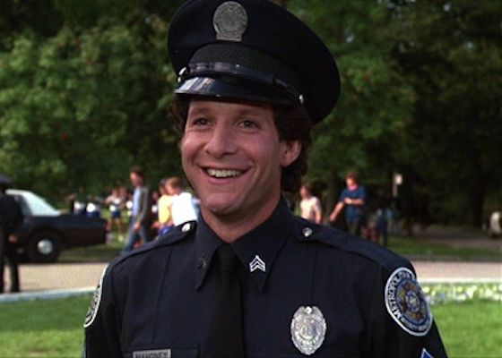 "A screen capture of the actor Steve Guttenberg from the movie ""Police Academy."""